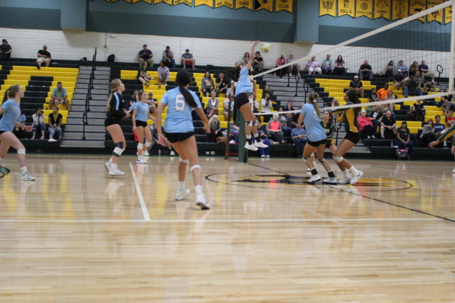Sophomore Elizabeth Rupp,middle hitter, going in for the kill against Peoria High School.
